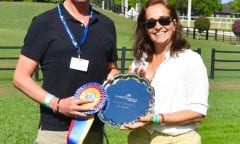 Carl Hester receives the Premier Equestrian Award  at the Adequan® Global Dressage Festival CDI 5*- JRPR's Joann Weiber presenting (JRPR Photo)