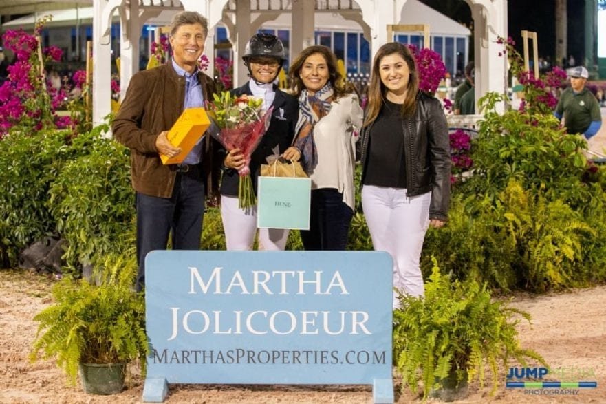 Left to right: Dr. Stephen Norton, Erynn Ballard, Martha Jolicoeur, and Isabelle Jolicoeur celebrate Ballard's Martha Jolicoeur Leading Lady Rider Award for WEF 5. Photo by Jump Media