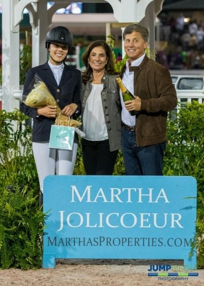 Martha Jolicoeur (center) presents Karen Polle (left) with the Martha Jolicoeur Leading Lady Rider Award for WEF 9 along with Dr. Stephen Norton. Photo by Jump Media
