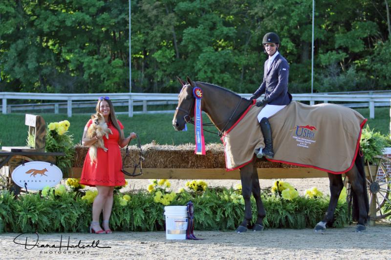 Kendall Meijer (left) of Copper Fox LLC presented Peter Pletcher and Quintessential with their awards following their win in the ,000 USHJA International Hunter Derby at the 2018 Great Lakes Equestrian Festival. Photo: Diana Hadsall Photography